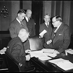FCA Governor Myers, standing at left, discusses the Farm Credit Bill with the Senate Banking and Currency Committee (Library of Congress, 1935)