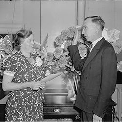 """Forrest (""""Frosty"""") F. Hill, governor, takes oath of office on Sept. 21, 1938. Elsie England, secretary to FCA's general counsel administers oath. He serves until March 26, 1940.  (Library of Congress)"""
