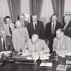 President Eisenhower signs the Farm Credit Act of 1953 on August 6, 1953.