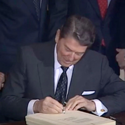 President Ronald Reagan signs the Agricultural Credit Act of 1987 on Jan. 6, 1988.