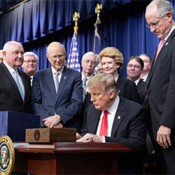 President Trump signs the Agriculture Improvement Act of 2018 on Dec. 20, 2018.
